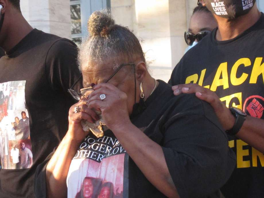Carol Sanders wipes her eyes after speaking at a news conference in Asbury Park N.J. on Sept. 23, 2020 about the fatal police shooting of her son Hasani Best during a domestic dispute last month in which he threatened to stab a police officer. Relatives and friends of Best called on authorities to bring criminal charges against one or more police officers in the case, which will be reviewed by a grand jury. Photo: Wayne Parry, AP / Copyright 2020 The Associated Press. All rights reserved.