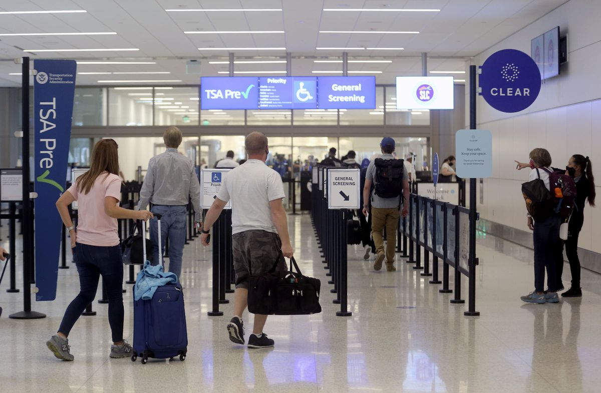 Travelers make their way through the Transportation Security Administration checkpoint at the new Salt Lake City International Airport in Tuesday, Sept. 22, 2020.