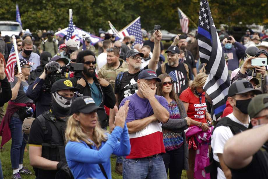 Members of the Proud Boys and other right-wing demonstrators rally, Saturday, Sept. 26, 2020, in Portland, Ore. Photo: Allison Dinner, AP / Copyright 2020 The Associated Press. All rights reserved