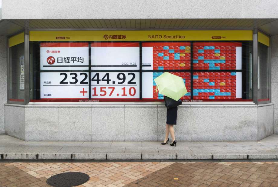 A woman looks at screens showing Japan's Nikkei 225 index at a securities firm in Tokyo on Friday, Sept. 25, 2020. Asian shares advanced Friday, cheered by a modest rally on Wall Street and rising hopes for fresh stimulus for the U.S. economy. Photo: Hiro Komae, AP / Copyright 2020 The Associated Press. All rights reserved