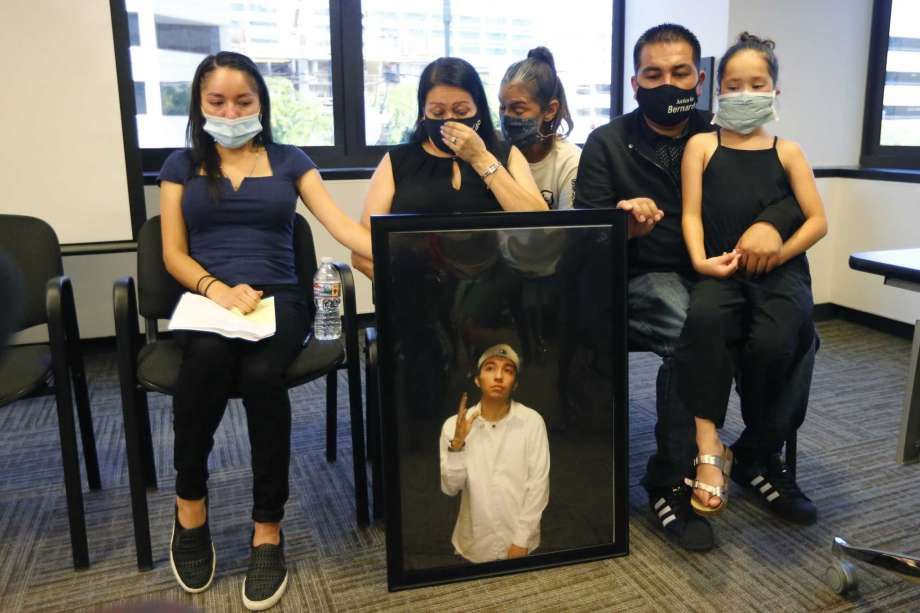 FILE - In this Thursday, July 9, 2020, file photo, Lucy Carbajal, center left, sits behind a photograph of her son Bernardo Palacios-Carbajal while other family members look on during a news conference at their attorney's office in Salt Lake City. District Attorney Sim Gill says Utah police officers were legally justified in firing more than 30 times and killing an armed man as he ran away. The case has become a rallying point for protesters in the state amid a national wave of dissent against police brutality. Gill said 22-year-old Bernardo Palacios-Carbajal was shot as he ran from Salt Lake City police officers who were investigating a gun-threat call and had yelled for him to drop a gun. The family of a Utah man who was killed and shot at more than 30 times as he ran from police filed a lawsuit against the Salt Lake City police department Friday, Sept. 25, 2020. Photo: Rick Bowmer, AP / Copyright 2020 The Associated Press. All rights reserved