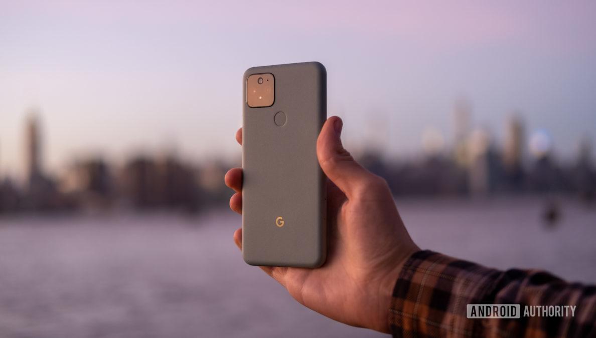 Google Pixel 5 in hand sunset back 2