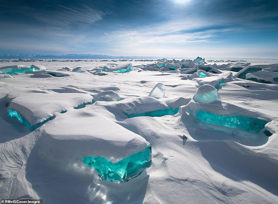 Alexey Trofimov was voted Public Favorite for this shot of the turquoise ice of Siberia's Lake Baikal as it glistened underneath a blanket of snow. 'The light that the sun gave, refracting in blocks of ice, caught my attention and made me take this picture,' Trofimov said