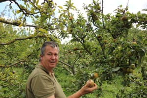 Michael Boase, assistant site manager at Horsenden farm, posing with an apple in the community orchard.