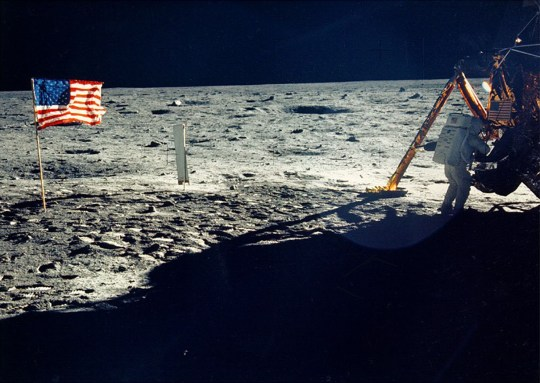 One of the few photographs of Neil Armstrong on the moon shows him working on his space craft on the lunar surface