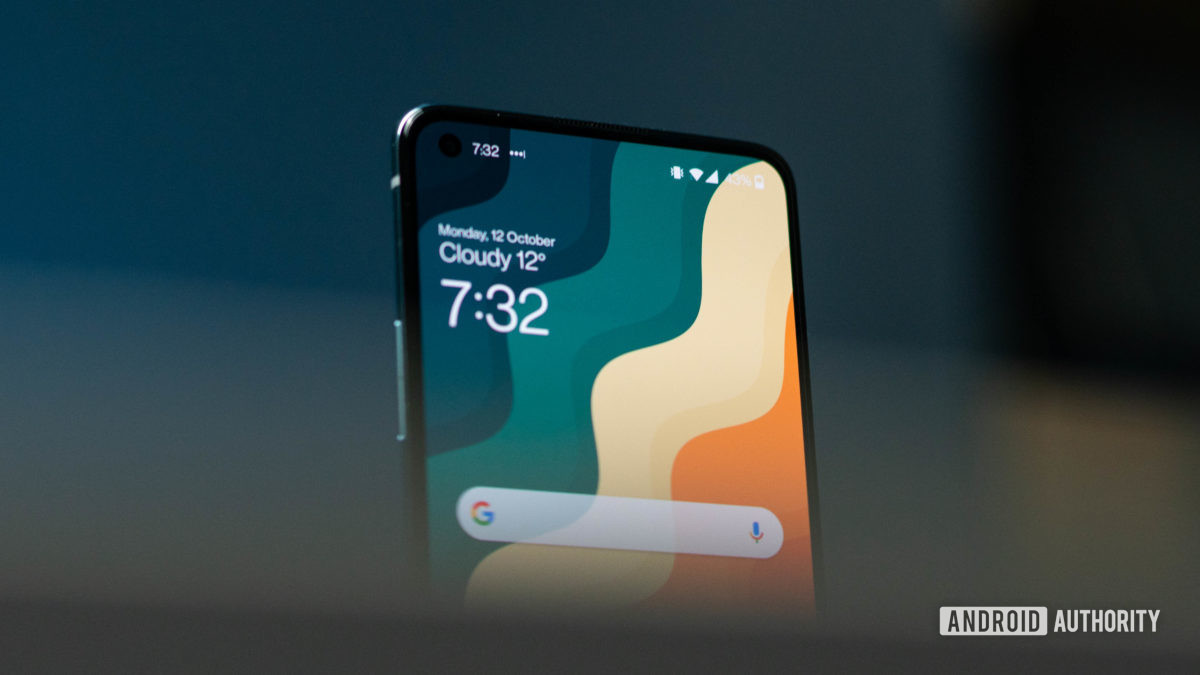 OnePlus 8T angled front hero shot focusing on the top of the display