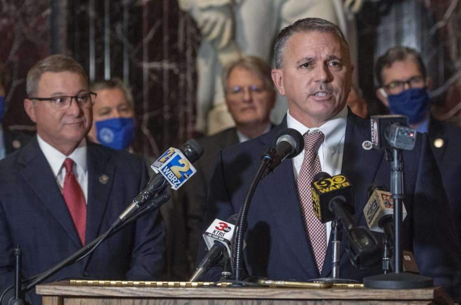 House Speaker Clay Schexnayder, R-Gonzales, at lectern, and Senate President Page Cortez, R-Lafayette, left, answer questions at a news conference in Memorial Hall before the start of the Special Legislative Session, Monday, Sept. 28, 2020, in Baton Rouge, La. (Bill Feig/The Advocate via AP) Photo: Bill Feig, AP / © 2020 The Advocate