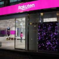 Signage for Rakuten Mobile Inc. is displayed outside one of the company's stores in Tokyo in January. | BLOOMBERG