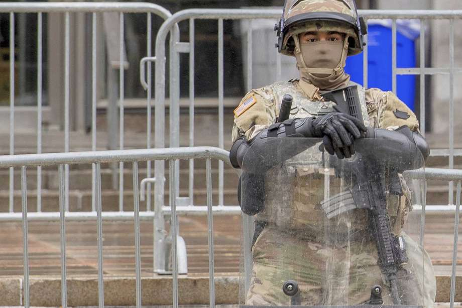 A member of the National Guard stands guard in front of the Philadelphia Municipal Services Building in Philadelphia, Pa., Friday, Oct. 30, 2020. (Jose F. Moreno/The Philadelphia Inquirer via AP) Photo: Jose F. Moreno, AP / © Copyright 2020 Philadelphia Media Network