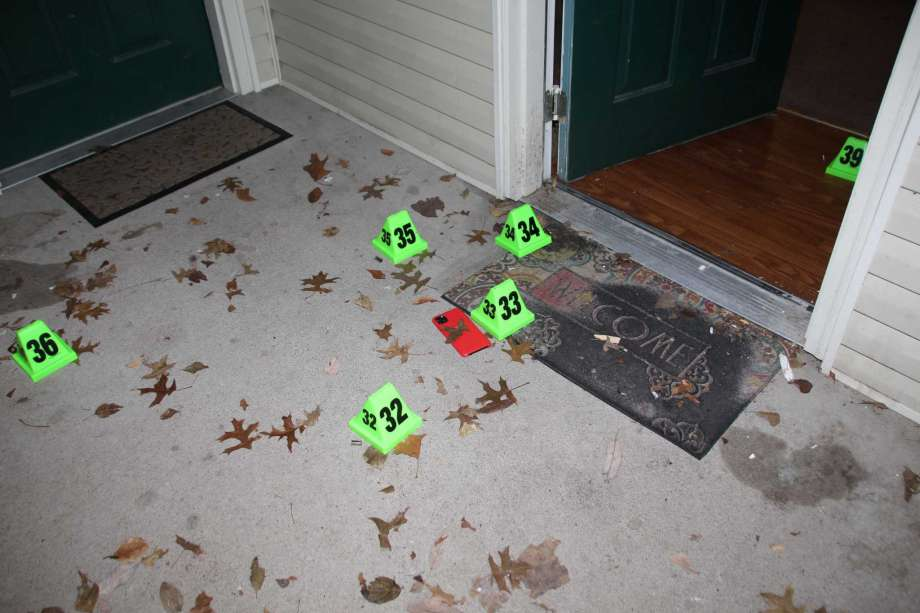 In this crime scene evidence photo released by the Louisville Metro Police Department, Louisville Police marked shell casings are seen at the front door of Breonna Taylor's apartment after she was fatally shot by police in Louisville, Ky., on March 13, 2020. The Kentucky Attorney General said in October that two long rifle shell casings were also found at the scene after the police raid that killed Taylor. (Louisville Metro Police Department via AP) Photo: AP / Louisville Metro Police Department