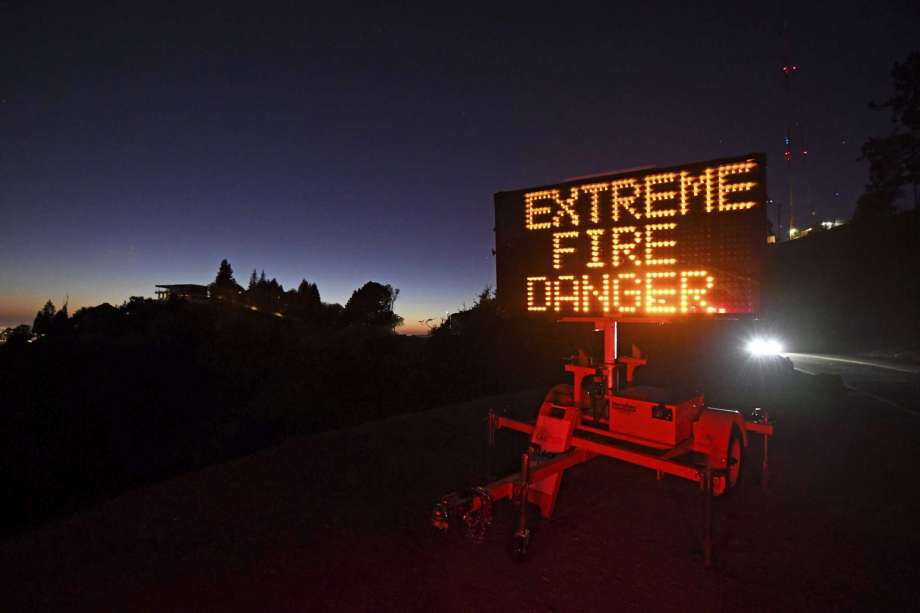 A roadside sign warns motorists of extreme fire danger on Grizzly Peak Boulevard, in Oakland, Calif., Sunday, Oct. 25, 2020. Due to high winds and dry conditions PG&E will turn off the power to over 361,000 customers in 36 counties to protect them from possible wildfires caused by downed power lines. The National Weather Service predicts offshore winds from the north peaking at higher elevations up to 70 mph. (Jose Carlos Fajardo/Bay Area News Group via AP) Photo: Jose Carlos Fajardo, AP / @BAY AREA NEWS GROUP 2020