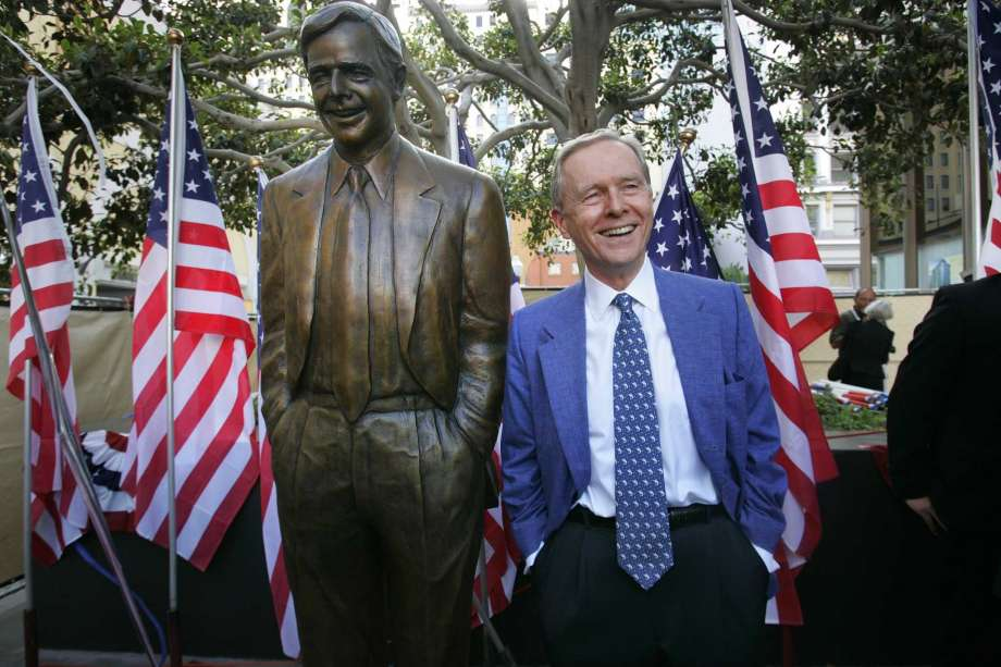 FILE - In this Aug. 25, 2007, file photo, former California Gov. Pete Wilson imitates the pose of a statue dedicated in his honor at Horton Plaza in San Diego. The statue was removed from the park after critics said the governor supported laws and policies that hurt immigrants and LGBTQ community members, the San Diego Union-Tribune reported Thursday, Oct. 16, 2020.  (Nelvin Cepeda/The San Diego Union-Tribune via AP) Photo: Nelvin C. Cepeda, AP / The San Diego Union-Tribune