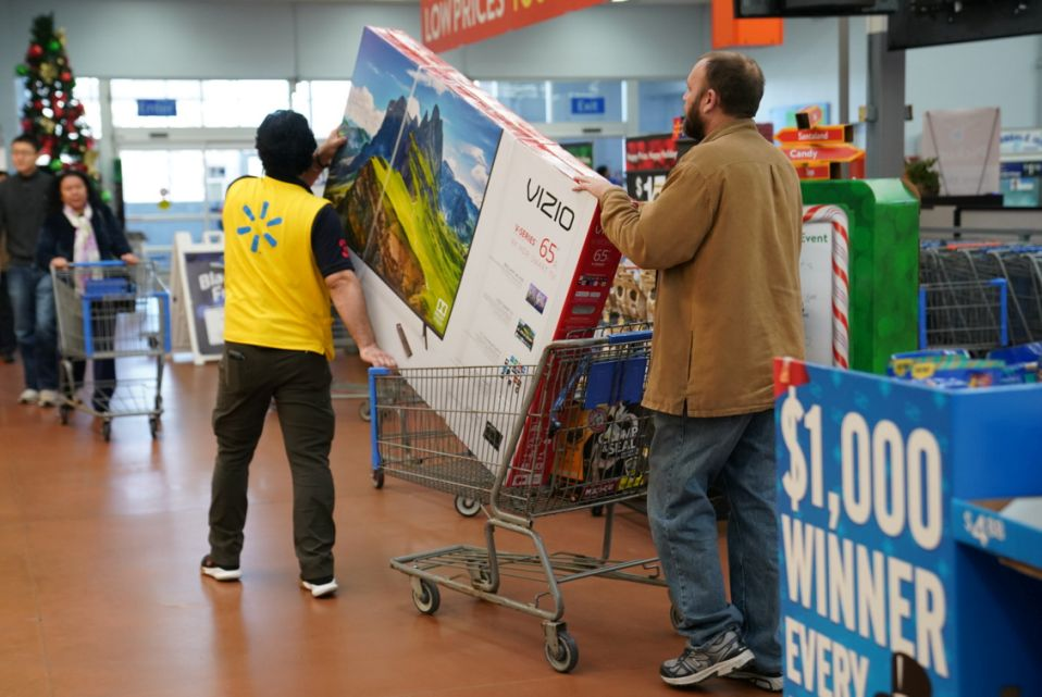 A man pushes a television in a shopping cart in Walmart on Black Friday, a day that kicks off the holiday shopping season, in King of Prussia, Pennsylvania, U.S., on November 29, 2019. REUTERS/Sarah Silbiger.