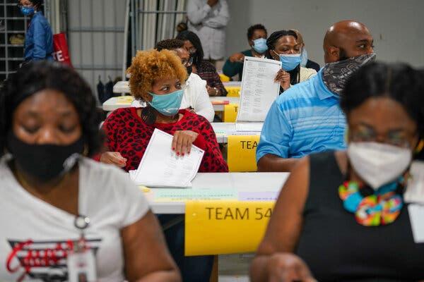 Election workers recounting ballots inGwinnett County, Ga., last week.