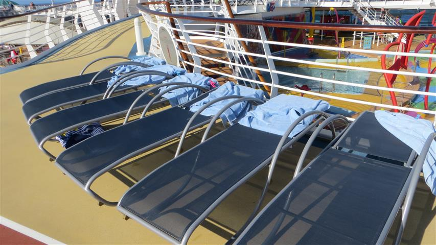 Hogged chairs on a cruise deck