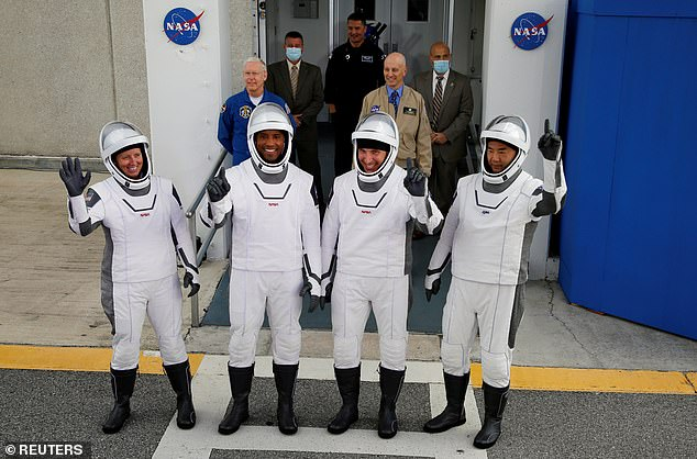 Glover took the 240 mile trip with his commander Michael Hopkins and fellow astronauts Shannon Walker and Soichi Noguchi from the Japanese space agency, JAXA
