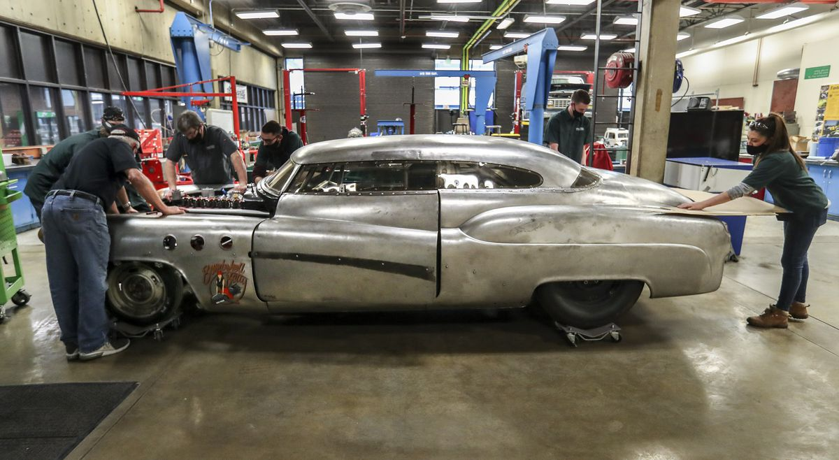 """UVU automotive students and staff work on """"Bombshell Betty,"""" the iconic 1952 Buick that broke six land speed world records at the Bonneville Speedway in Utah, at the Sparks Automotive building on the UVU campus in Orem on Wednesday, Nov. 18, 2020. The team has updated and reengineered the vehicle to break the 200 mph mark."""