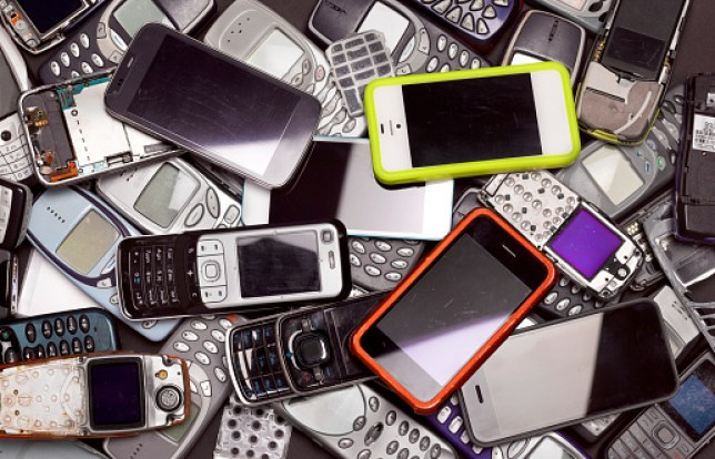 Old mobile phones lying in a pile