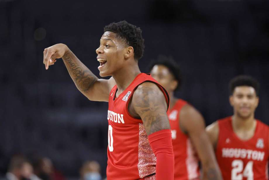Houston guard Marcus Sasser (0) reacts after making a three-point shot against Texas Tech during the first half of an NCAA college basketball game, Sunday, Nov. 29, 2020, in Fort Worth, Texas. Photo: Ron Jenkins, AP / FR171331 AP