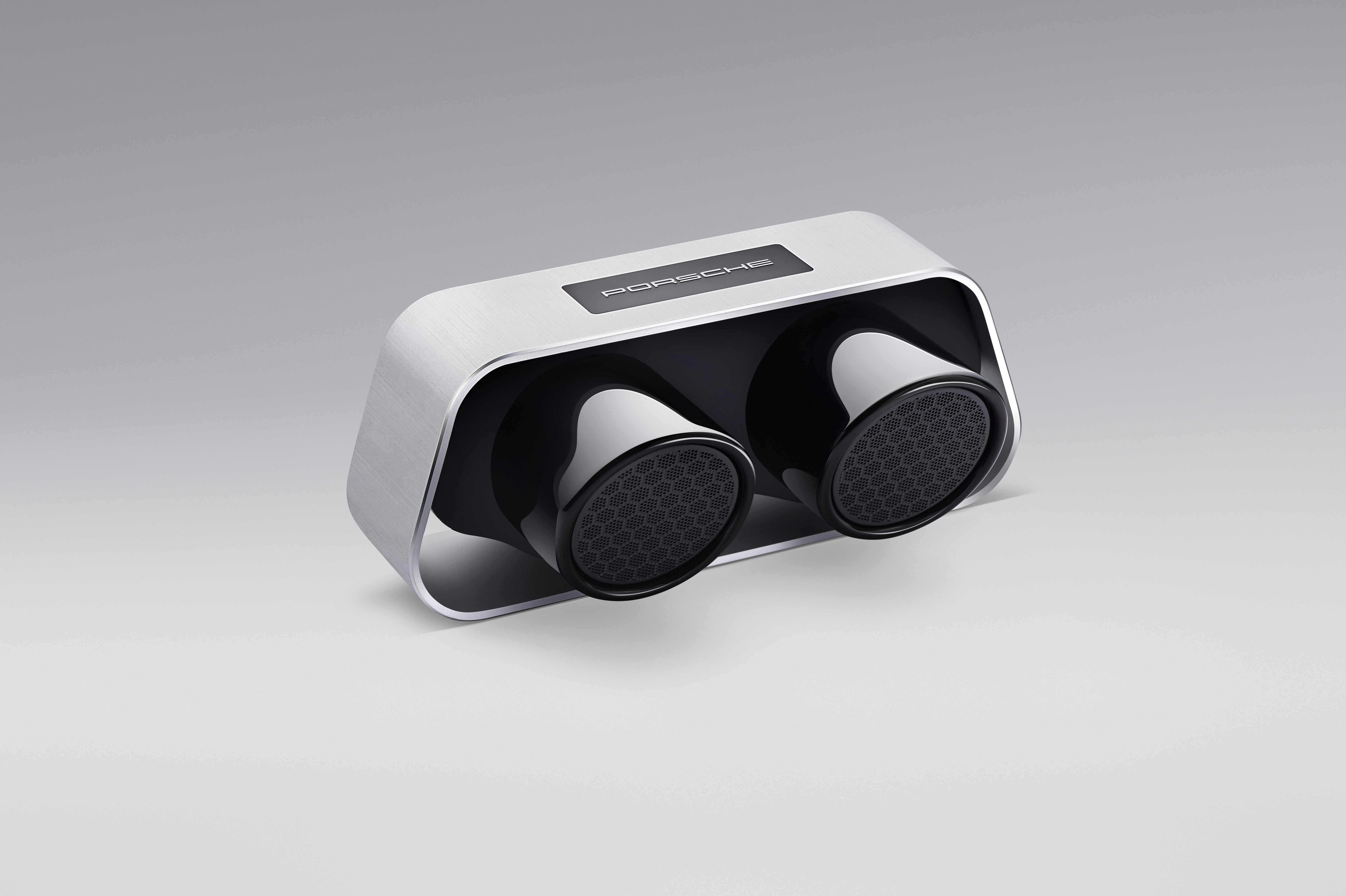 The original tailpipe from a 911 GT3 as a high- end Bluetooth loudspeaker. Yes please. Has up to 24 hours of battery life. Head to shop2. porsche.com/uk