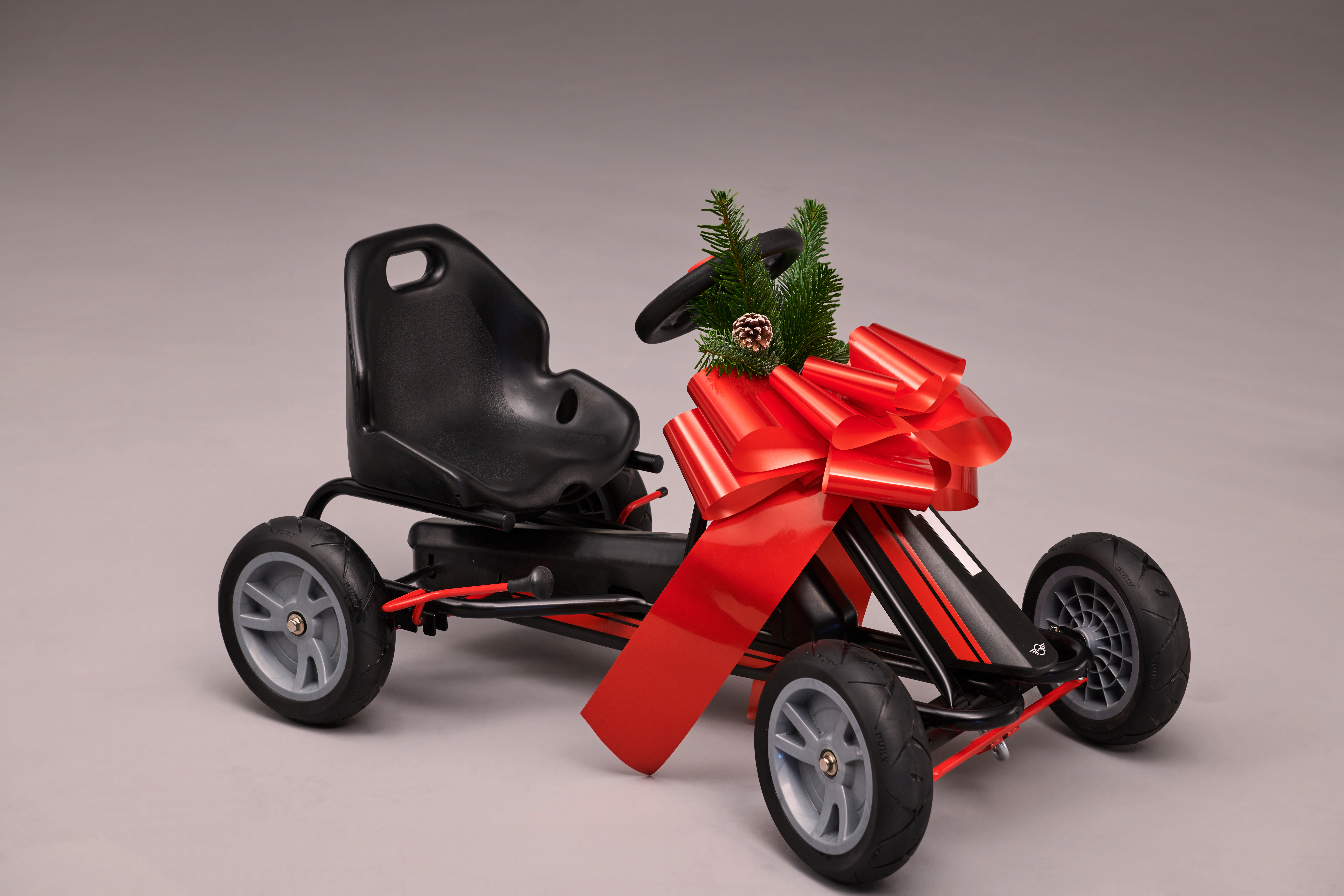 We say Minis handle like a go-kart, well, here's a go-kart Mini. Adjustable seat, handbrake and horn. For kids aged 3yrs or 95cm tall. Go to shop.mini.co.uk.