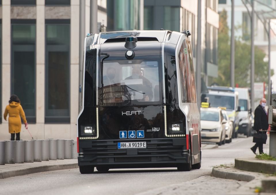 23 October 2020, Hamburg: A Hamburger Hochbahn minibus running without a driver drives through HafenCity. The first passengers have been able to use the autonomous shuttle since Friday. Photo: Daniel Bockwoldt/dpa (Photo by Daniel Bockwoldt/picture alliance via Getty Images)
