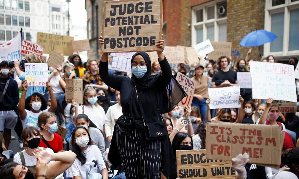 A-level students hold placards as they protest in August outside the Department for Education in London amid the outbreak of the coronavirus disease