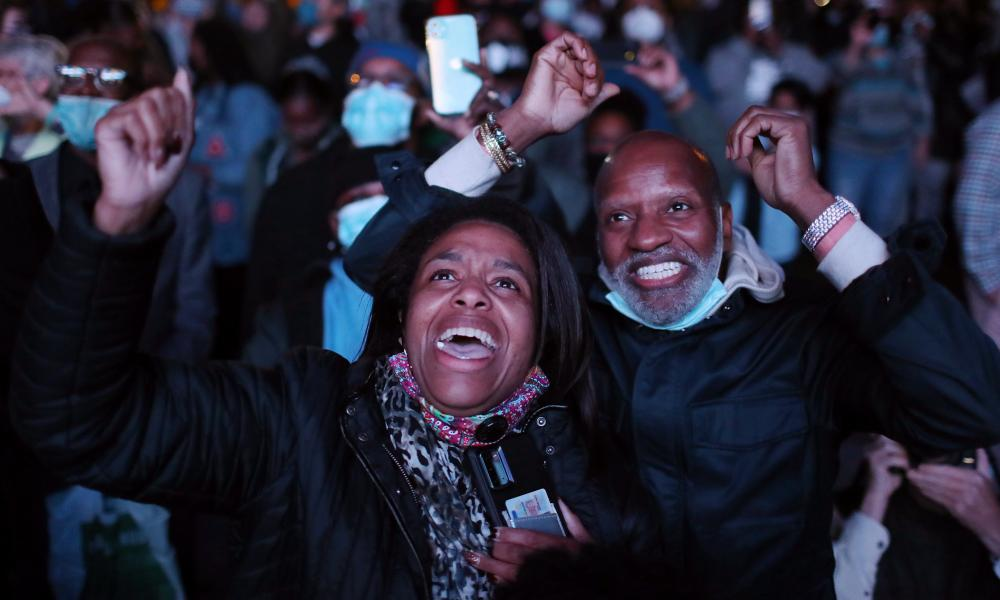Jailyn Banks and King M celebrate as president-elect Joe Biden arrives on stage at the Chase Center in San Francisco to address the nation