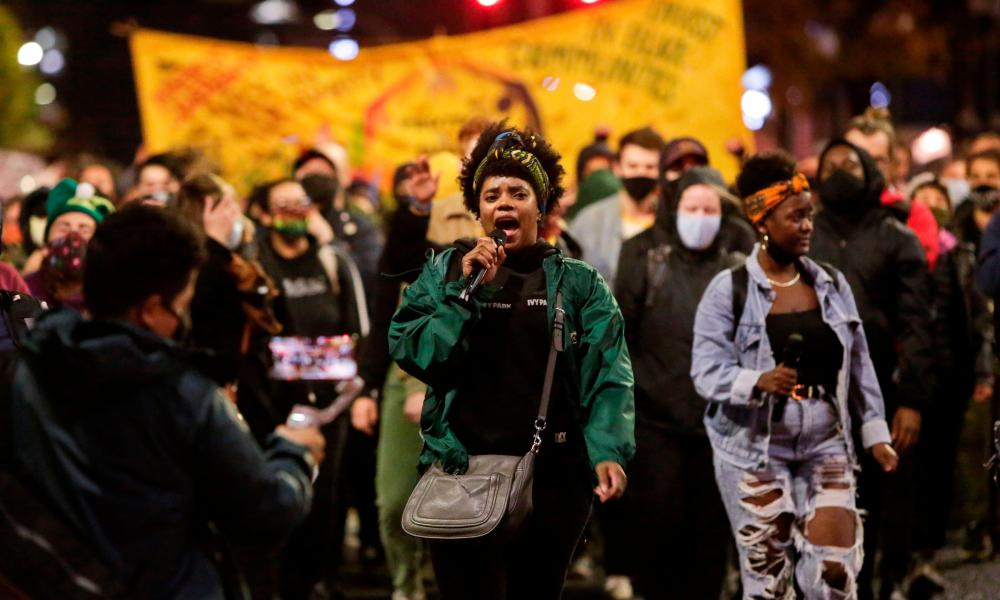 Trae, who did not wish to use a last name, of the Black Action Coalition, leads chants during a march to 'Count Every Vote, Protect Every Person' a day after the US presidential election in Seattle, Washington on 4 November