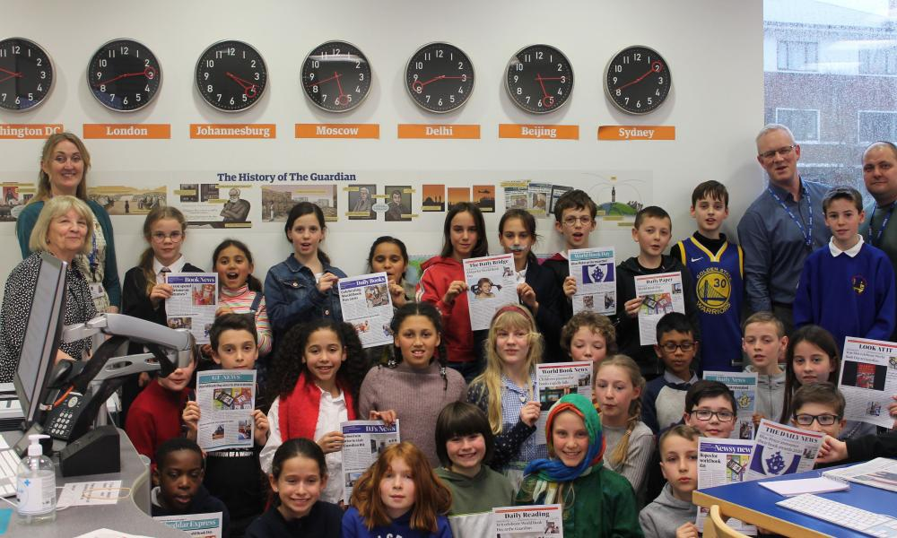 Students hold up their final front pages on World Book Day on 5 March