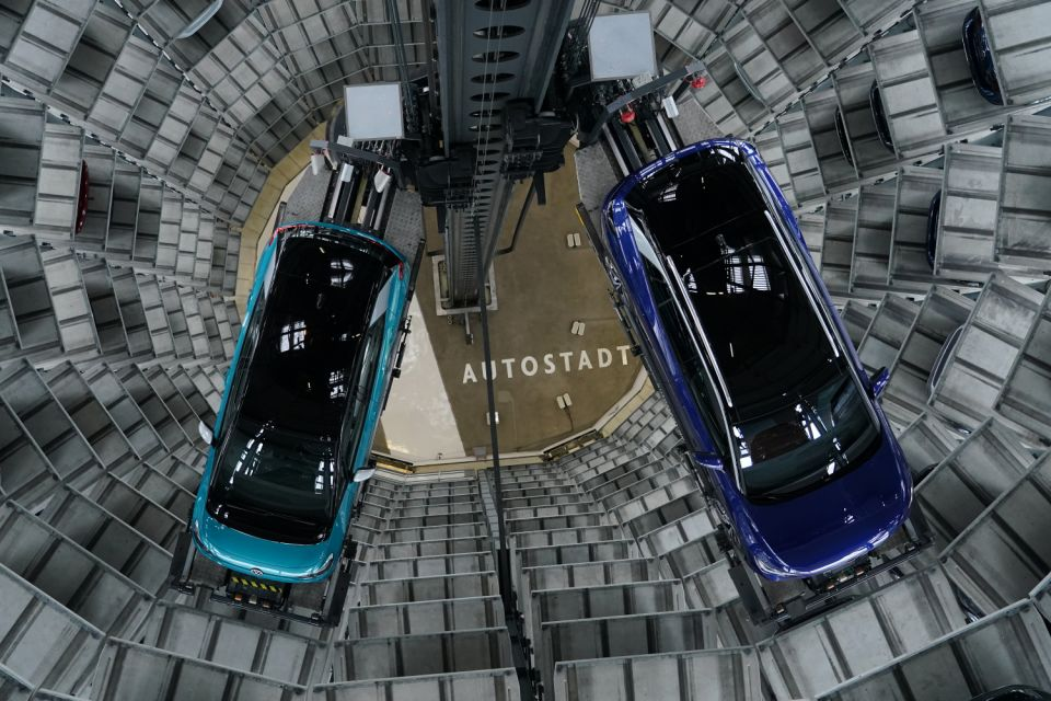 WOLFSBURG, GERMANY - OCTOBER 26: Volkswagen ID.4 (R) and ID.3 electric cars stand on elevator platforms inside one of the twin towers used as storage at the Autostadt promotional facility next to the Volkswagen factory on October 26, 2020 in Wolfsburg, Germany. The ID.3 and ID.4 are Volkswagen's first real effort to break into the growing electric car market and are aimed for mass appeal.   (Photo by Sean Gallup/Getty Images)