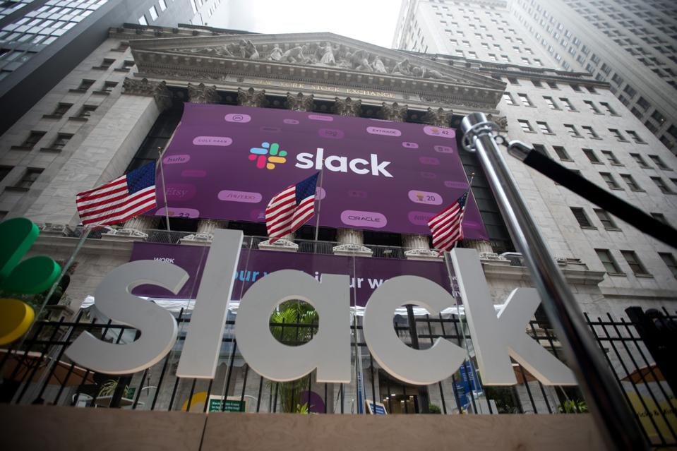 Slack signage is displayed outside of the New York Stock Exchange (NYSE) during the company's iPO in 2019.