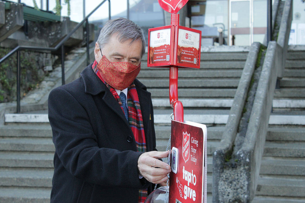Saanich Mayor Fred Haynes kicked off the Salvation Army's 2020 Christmas Kettle Campaign outside municipal hall on Dec. 1 with an inaugural contactless donation. (Devon Bidal/News Staff)