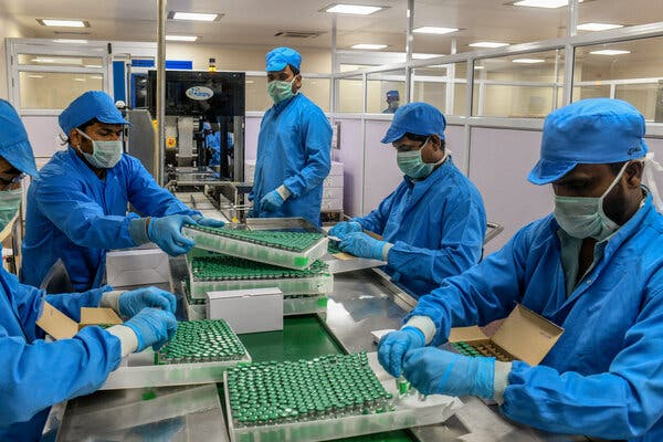 Workers packing doses of the Covishield vaccine at the Serum Institute of India in Pune. Nepal approved the vaccine on Friday.