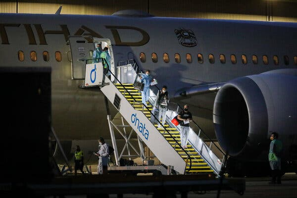 Tennis players and their support teams disembarking on Thursday from one of 17 flights that the organizers of the Australian Open chartered to bring participants to Melbourne.