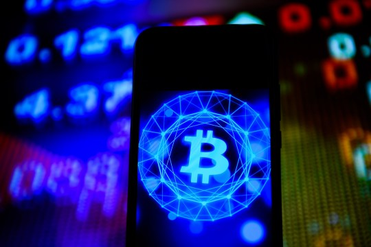 A Bitcoin logo seen displayed on a smartphone
