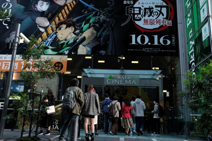 Film-goers line up to see  'Demon Slayer: Kimetsu no Yaiba' in the Shinjuku District of Tokyo in October
