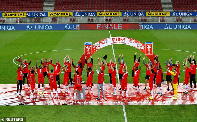 FC Red Bull Salzburg players celebrate winning the Austrian Cup on May 20, 2020. Play resumed behind closed doors following the outbreak of the coronavirus disease