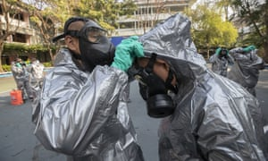 Soldiers from Royal Thai Army Chemical Department prepare to spray disinfectant as a precaution against the coronavirus at Bang Bua school in Bangkok, Thailand, Tuesday, 26 January 2021.
