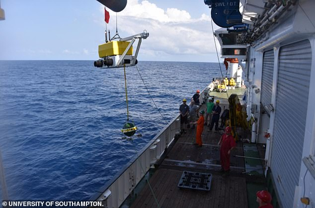 Deploying one of the seismometers into the Atlantic. The devices provided the first large scale and high-resolution imaging of the mantle beneath the MAR, researchers say