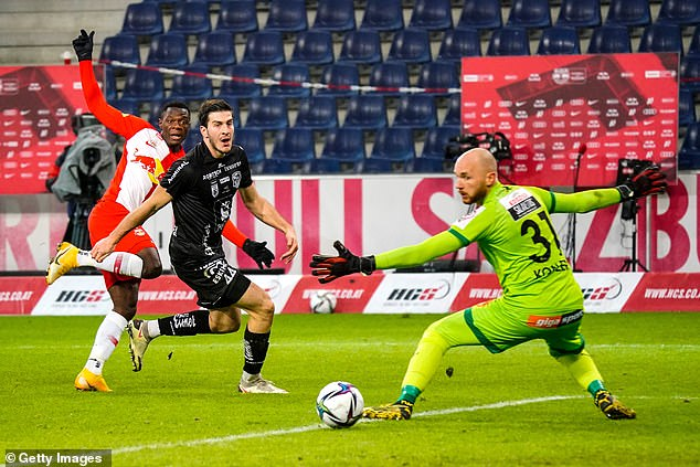 Patson Daka of FC Red Bull Salzburg puts the ball past Wolfsberger AC players Lukas Lochoshvili and Alexander Kofler at Red Bull Arena on December 20, 2020 in Salzburg, Austria, sans spectators. Researchers analysed matches played by FC Red Bull Salzburg, the current champions of the Austrian Bundesliga, the country's top tier for men's football