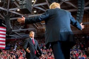 Donald Trump greets talk show host Sean Hannity at a Make America Great Again rally in Cape Girardeau, Missouri, in November 2018.