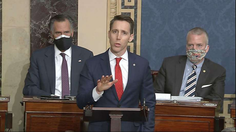 In this image from video, Sen. Josh Hawley, R-Mo., speaks as the Senate reconvenes to debate the objection to confirm the Electoral College Vote from Arizona, after protesters stormed into the U.S. Capitol on Wednesday, Jan. 6, 2021. (Senate Television via AP) Photo: AP / Copyright 2020 The Associated Press. All rights reserved