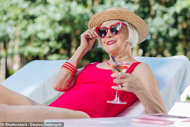 Sunbathing is an activity that many of us enjoy while on holiday, but a new study has warned of the dangers of spending time in the sun for post-menopausal women (stock image)