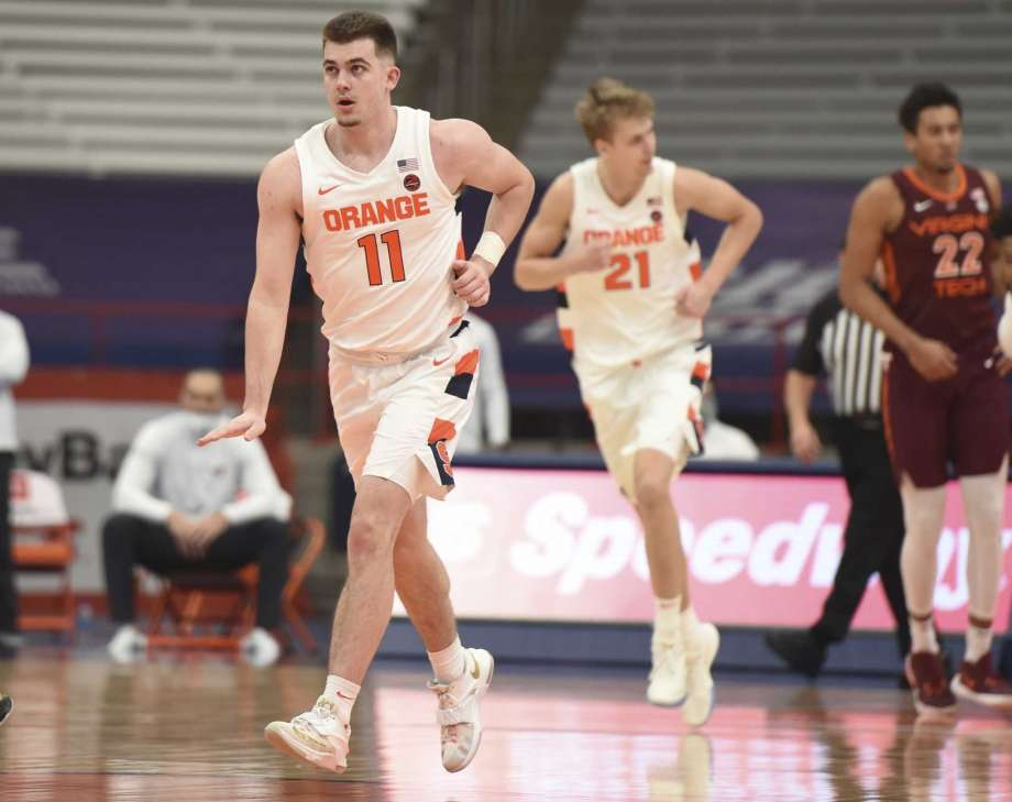 Syracuse guard Joseph Girard III (11) celebrates a basket against Virginia Tech  during an NCAA college basketball game at the Carrier Dome, Syracuse, N.Y., Saturday Jan. 23, 2021. (Scott Schild/The Post-Standard via AP) Photo: Scott Schild, AP / The Post-Standard