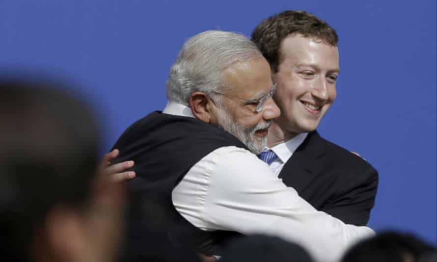 Mark Zuckerberg, right, hugs Narenda Modi at Facebook in 2015.