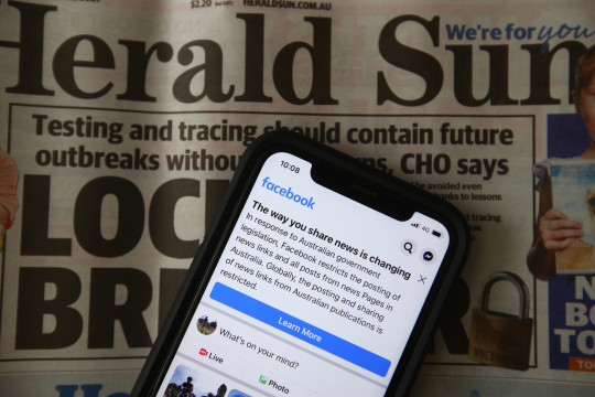 MELBOURNE, AUSTRALIA - FEBRUARY 18: In this photo illustration a message is seen on Facebook mobile, on February 18, 2021 in Melbourne, Australia. Facebook has banned publishers and users in Australia from posting and sharing news content as the Australian government prepares to pass laws that will require social media companies to pay news publishers for sharing or using content on their platforms. (Photo by Robert Cianflone/Getty Images)
