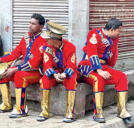 Three brass band musicians all set to begin their day around 9am