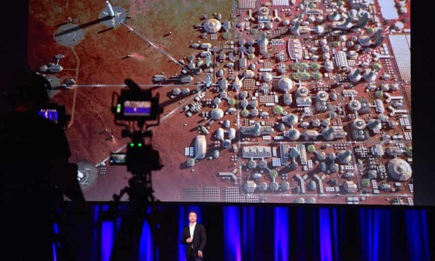 Elon Musk, founder of SpaceX, shows a depiction of a human colony on Mars.