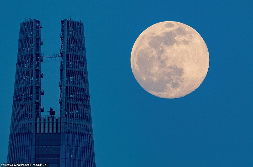 The moon is seen over the 123 storey Lotte World Tower in Seoul, South Korea, which at1,823 ft is the world's fifth tallest building